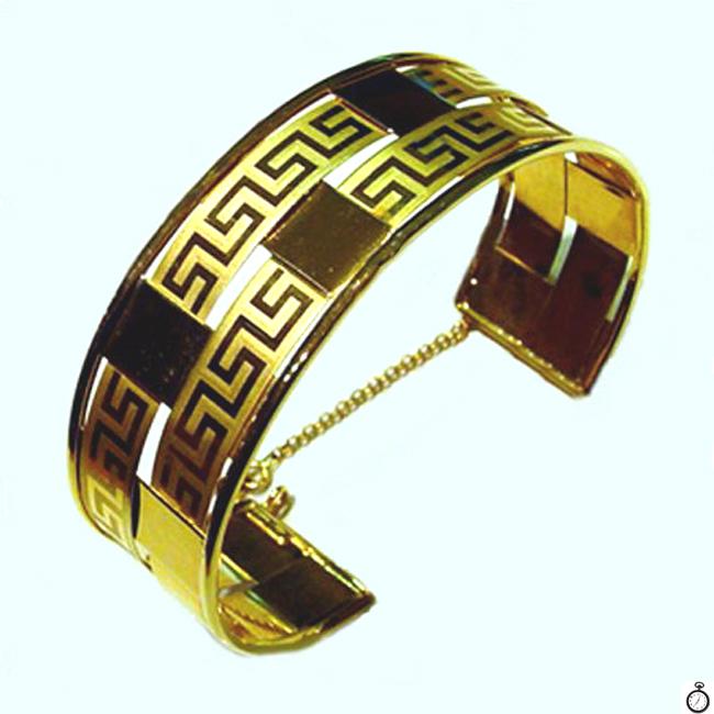c8de70a840a8 Pulsera brazalete de oro amarillo con grecas - joyeria.online